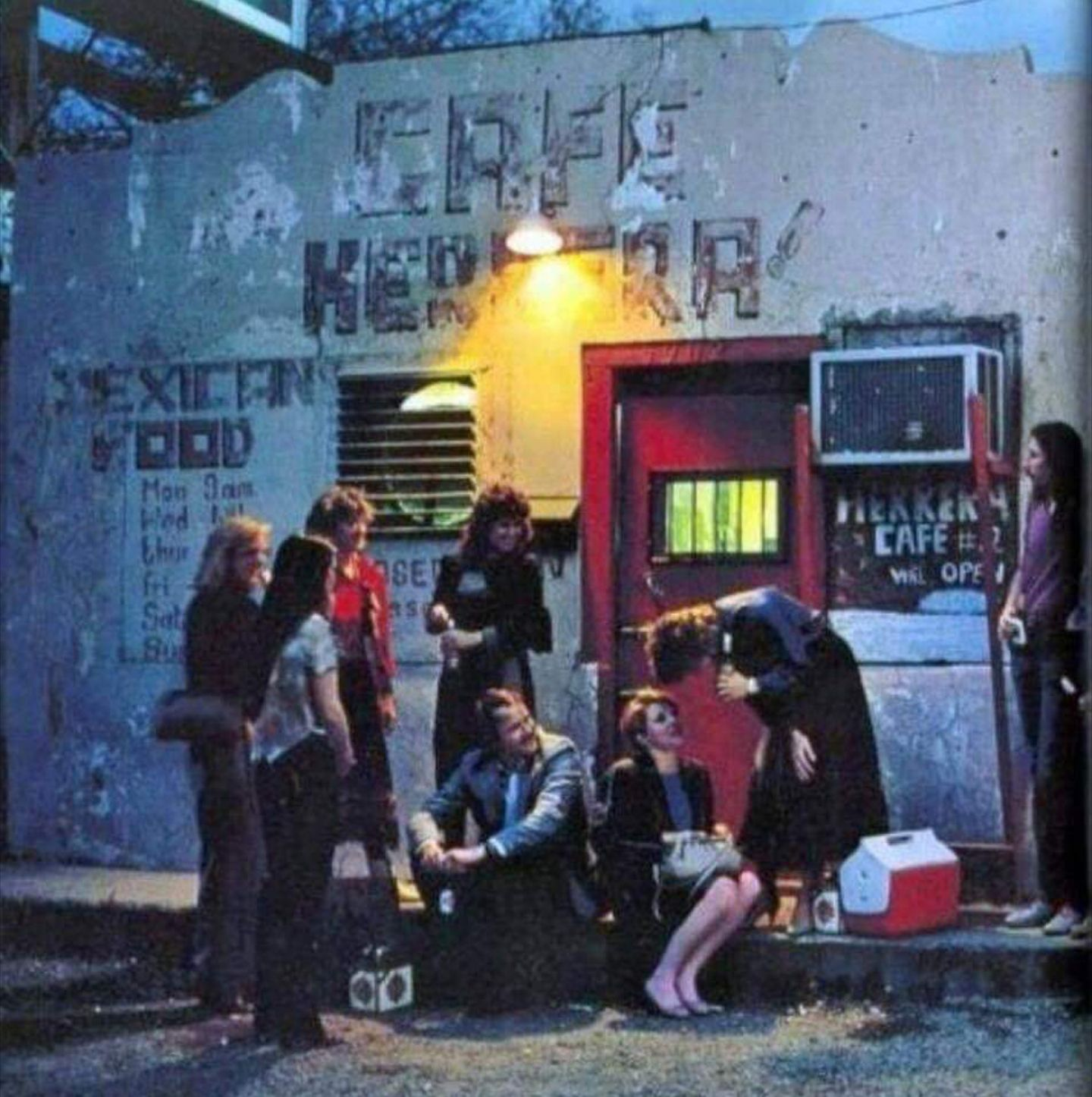 SMU students sit outside Herrera's Cafe with their coolers in the 1970s.