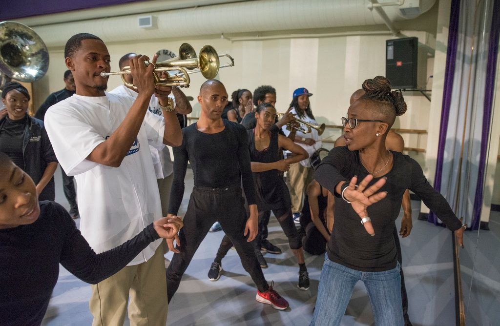 Dallas Black Dance Theatre and the Kickin' Brass Band rehearse Displaced, Yet Rebirthed with choreographer Michelle N. Gibson (right).