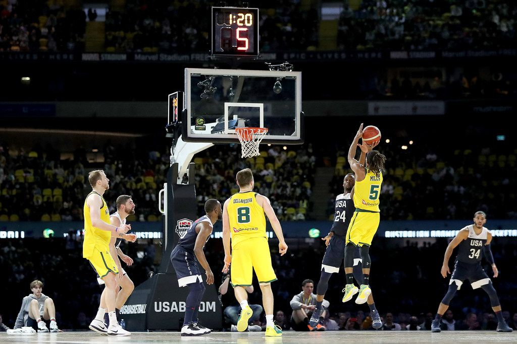 MELBOURNE, AUSTRALIA - AUGUST 24: Patty Mills of Australia shoots for three during game two of the International Basketball series between the Australian Boomers and United States of America at Marvel Stadium on August 24, 2019 in Melbourne, Australia. (Photo by Jonathan DiMaggio/Getty Images)