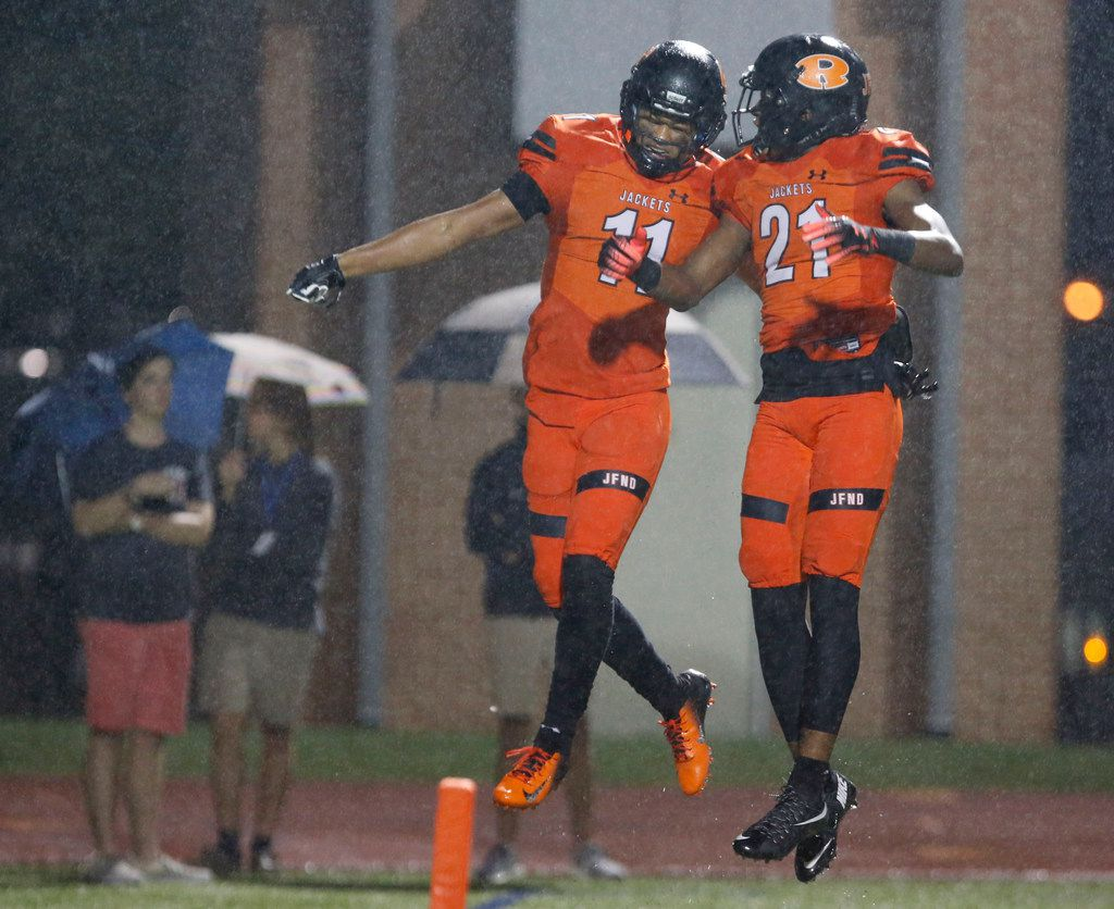 FILE - Rockwall's Jaxon Smith (11) and Alex Orji (21) perform a celebratory bump in the end zone, after Smith's touchdown during the first half of a high school football game against Rockwall-Heath at Wilkerson-Sanders Stadium in Rockwall, Friday, October 12, 2018. (John F. Rhodes / Special Contributor)