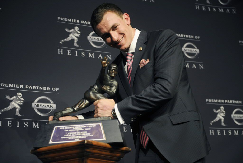 Texas A&M quarterback Johnny Manziel poses with the Heisman Trophy after becoming the first freshman to win the award, Saturday, Dec. 8, 2012, in New York. (AP Photo/Henny Ray Abrams) 12302012xPOINTS