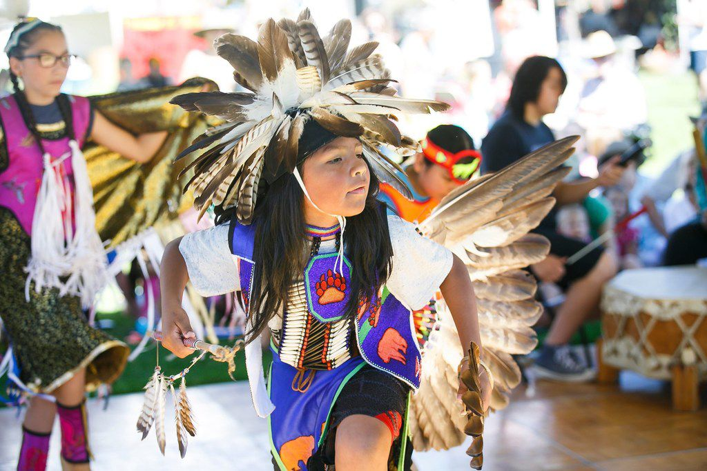 In this June 24, 2017, photo, Jessi Soliz dances as members of the Native American Cross Cultural Association perform at the 20th annual World Beat Festival at Riverfront Park in Salem, Ore. The Native American Cross Cultural Association advocate for more Native American studies and experiences to be shared in the classroom and encourage Native students to pursue their education.