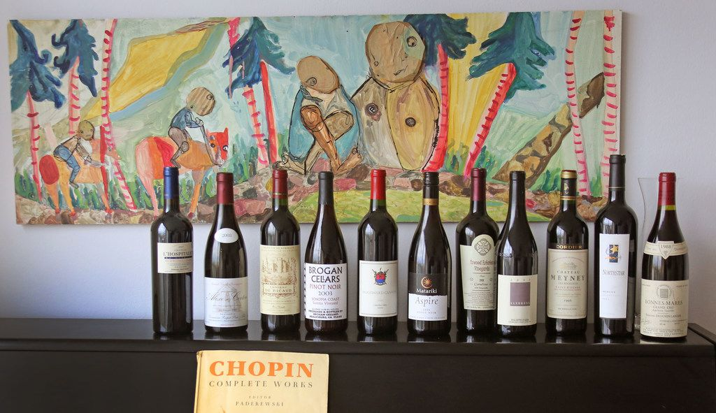 """A line-up of some of the wines tasted as the wine panel holds a special """"Open That Bottle"""" tasting, where sommeliers bring old wines and sample them, held at Tina Danze's home in Dallas on Monday, April 30, 2018.  (Louis DeLuca/The Dallas Morning News)"""