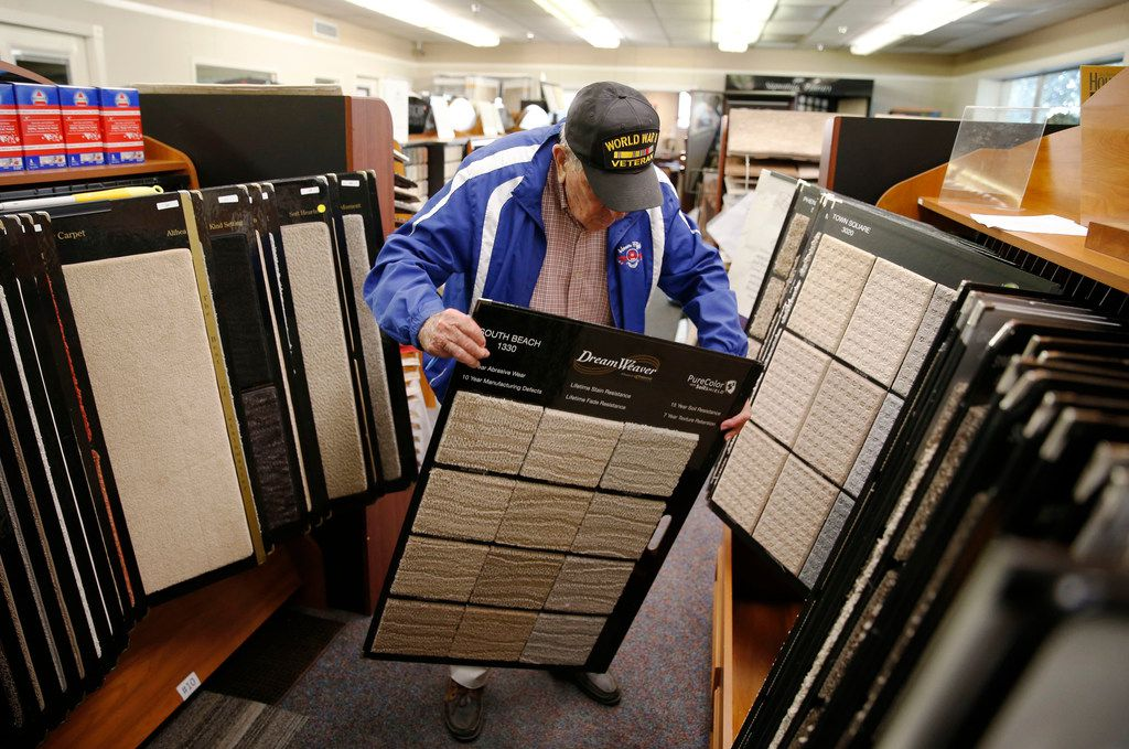 Chester Hollingsworth works on making sure the correct samples are on the right display case at S&H Distributing.
