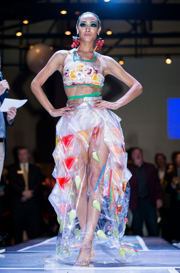 Model Alexis King walks down the runway wearing a dress accented with fruit and juices during the Greater Dallas Restaurant Association's Food in Fashion event on Wednesday, Feb. 7, 2018, at Trinity Groves in Dallas. The dress was designed by Roxanna Santana.