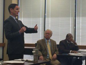 County Judge Clay Jenkins speaks at a Sandbranch meeting Wednesday, as EPA Regional Administrator Ron Curry and Dallas County Commissioner John Wiley Price look on. (Naomi Martin/Staff)