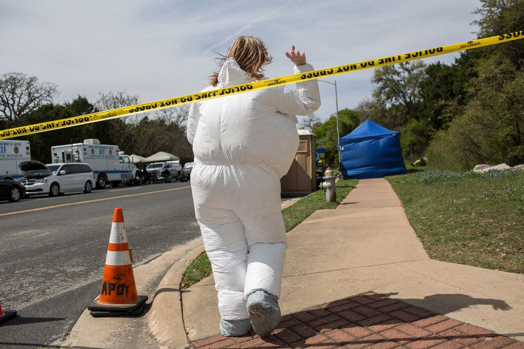Investigators at the scene of Sunday's explosion that injured two people in southwest Austin, March 19, 2018. A fourth bomb triggered by a tripwire suggests a higher level of sophistication in the wave of bomb attacks that have unnerved the residents of Austin. (Tamir Kalifa/The New York Times)