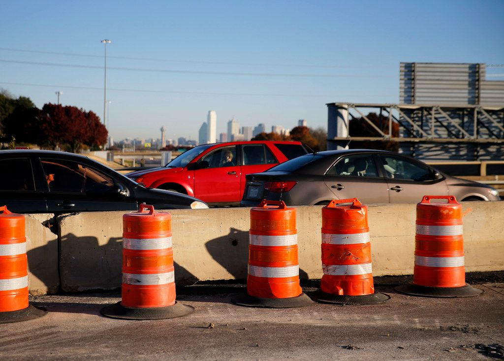 Traffic barrels mark where part of the Illinois Ave. bridge is shutdown in anticipation of its partial removal in Dallas, Wednesday, November 28, 2018.  Texas Department of Transportation is planning a full shutdown of the Interstate 35 main lanes from 9 p.m. Saturday to 3 p.m. Sunday to remove part of the bridge.  All main lane traffic will be diverted to the frontage roads and Illinois will be shut off in both directions. The bridge removal is part of the Southern Gateway project. (Tom Fox/The Dallas Morning News)