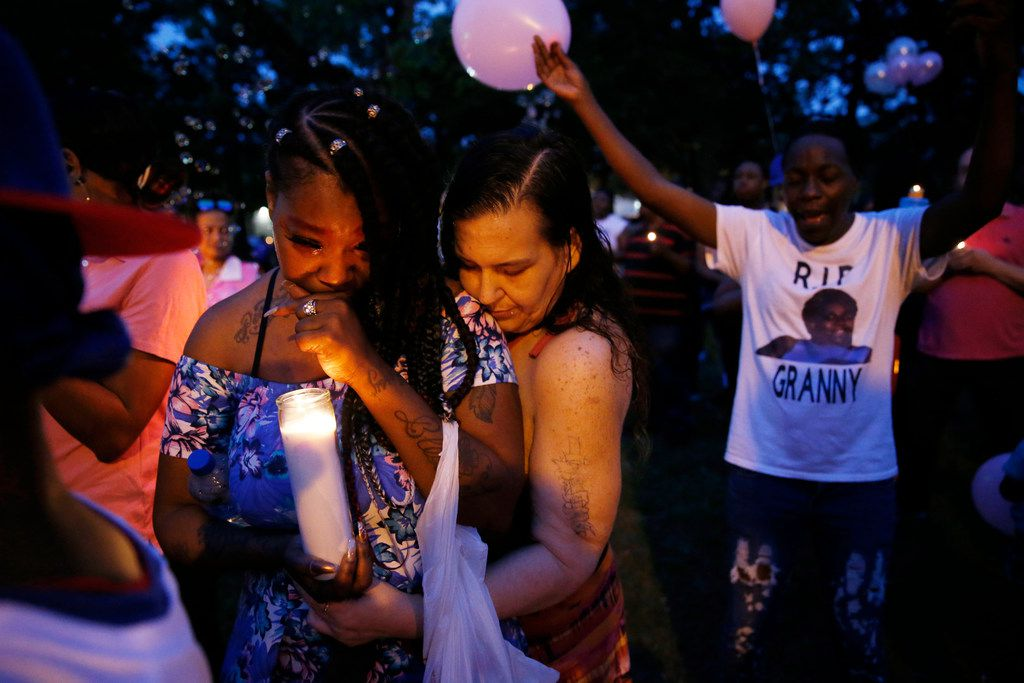 Ashley Jordan (center) was consoled by Honey during Booker's vigil.
