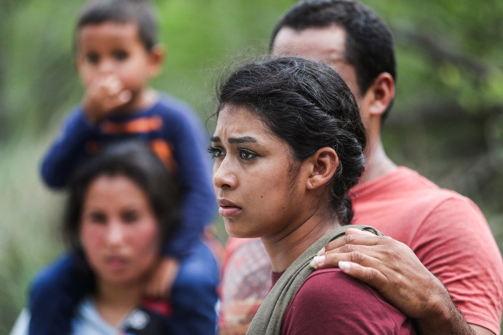 Central American asylum seekers turn themselves in to Border Patrol after crossing the Rio Grande into the United States on Friday, May 3, 2019, near McAllen.
