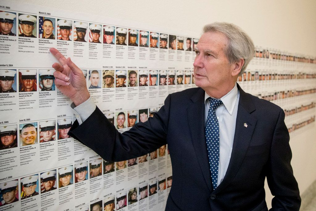 In this Oct. 25, 2017, photo, Rep. Walter Jones, R-N.C. points at a photograph of Marine Sgt. Michael Edward Bits of Ventura, Calif., the first military funeral he and his wife attended, and one of the many pictures of soldiers killed this century based in Camp Lejeune along a hallway leading to his office on Capitol Hill in Washington. As President Trump argued about what he said to the family of a soldier killed in Niger, a North Carolina congressman was quietly doing what he's done more than 11,000 times: signing a condolence letter to that family and others. Republican Rep. Walter Jones began signing the letters to families in 2003 as penance for his 2002 vote supporting war in Iraq.
