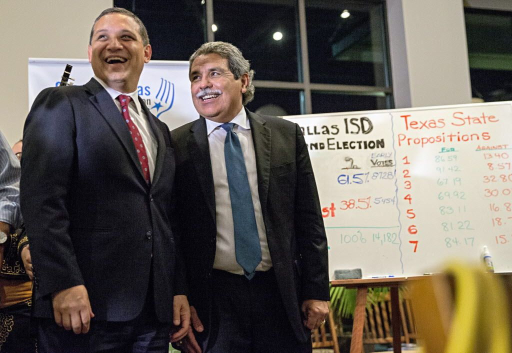 Dallas ISD trustee Edwin Flores (left) and Superintendent Michael Hinojosa attend a district bond election watch party Tuesday in Dallas. (G.J. McCarthy/The Dallas Morning News)