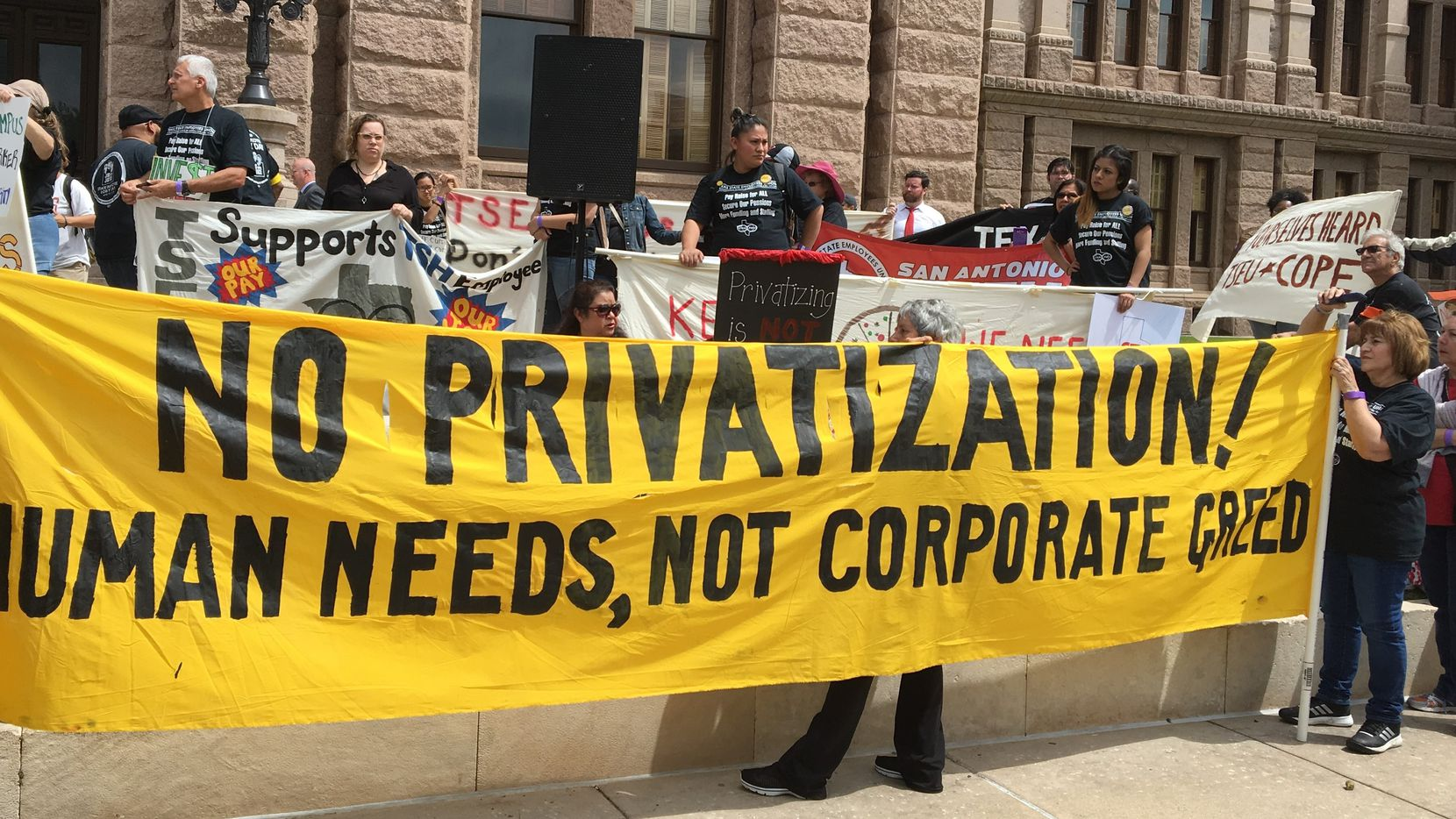 State agency and university employees who belong to a union protested low pay, inadequate staffing and privatization schemes Wednesday at a Capitol rally in Austin. (Robert T. Garrett/Staff)
