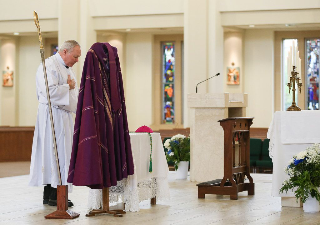Bishop Edward J. Burns removes his miter, crozier, episcopal ring, pectoral cross and zucchetto, all symbols of a bishop, as a sign of humility and penance during a Ceremony of Sorrow on Tuesday, Oct. 9, 2018 at St. Cecilia Catholic Church in Dallas. Following the service, the first of four town halls was held to address the current crisis of sexual abuse by clergy, including allegations of sexual abuse by the former pastor of St. Cecilia Catholic Church, Reverend Edmundo Paredes. (Ryan Michalesko/The Dallas Morning News)