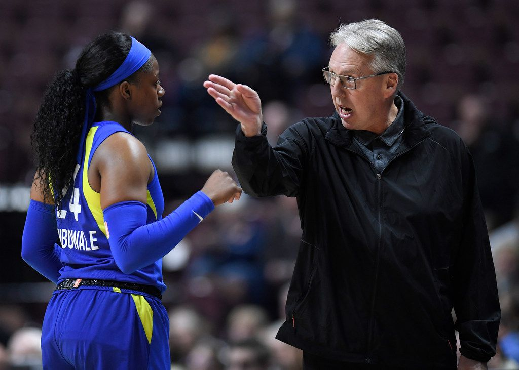 Dallas Wings head coach Brian Agler, right, talks with Dallas Wings' Arike Ogunbowale during the first half of a preseason WNBA basketball game against the Connecticut Sun, Tuesday, May 14, 2019, in Uncasville, Conn. (AP Photo/Jessica Hill)
