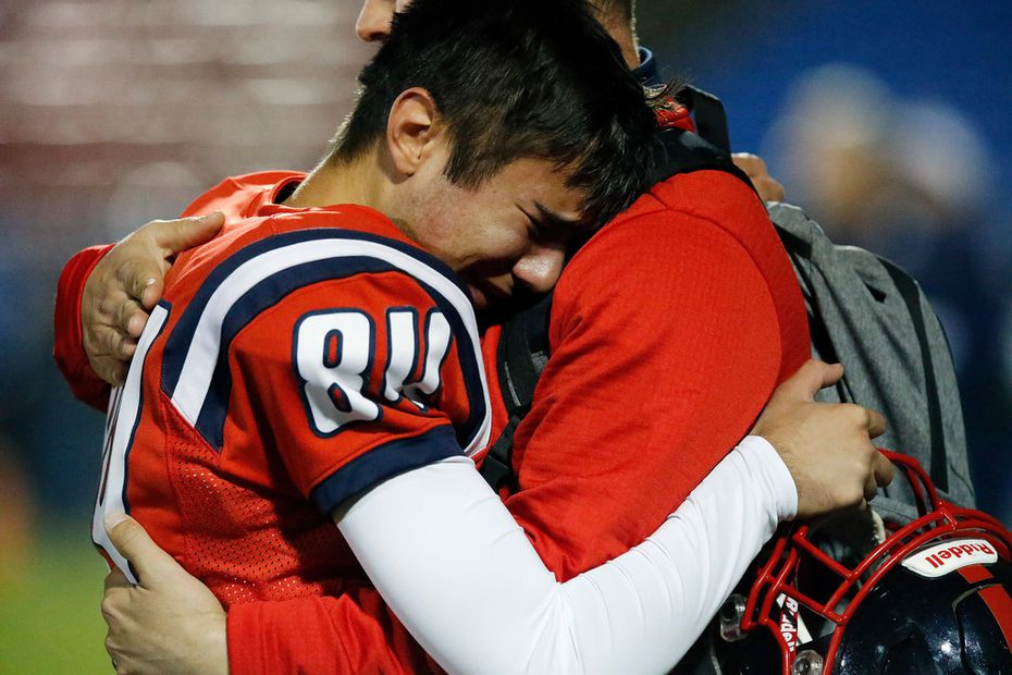 Centennial High School kicker Caleb Leal (84) is comforted by a coach after Centennial High School was defeated by Independence High School, 34-21 in a district 5-5A Division I football game at Toyota Stadium in Frisco on Friday night, November 9, 2018.  (Stewart F. House/Special Contributor)
