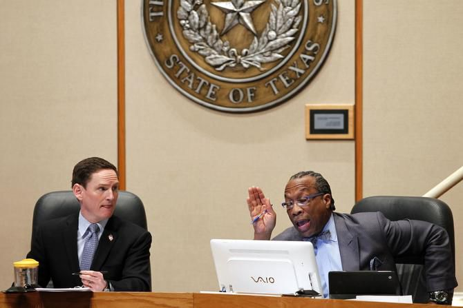 County Judge Clay Jenkins and Commissioner John Wiley Price discuss allowing other entities besides the North Texas Regional Certification Agency to certify women and minority owned businesses at the County Commissioner's Chambers in the Dallas County Administration Building on Tuesday, March 25, 2014. (Lara Solt/The Dallas Morning News)