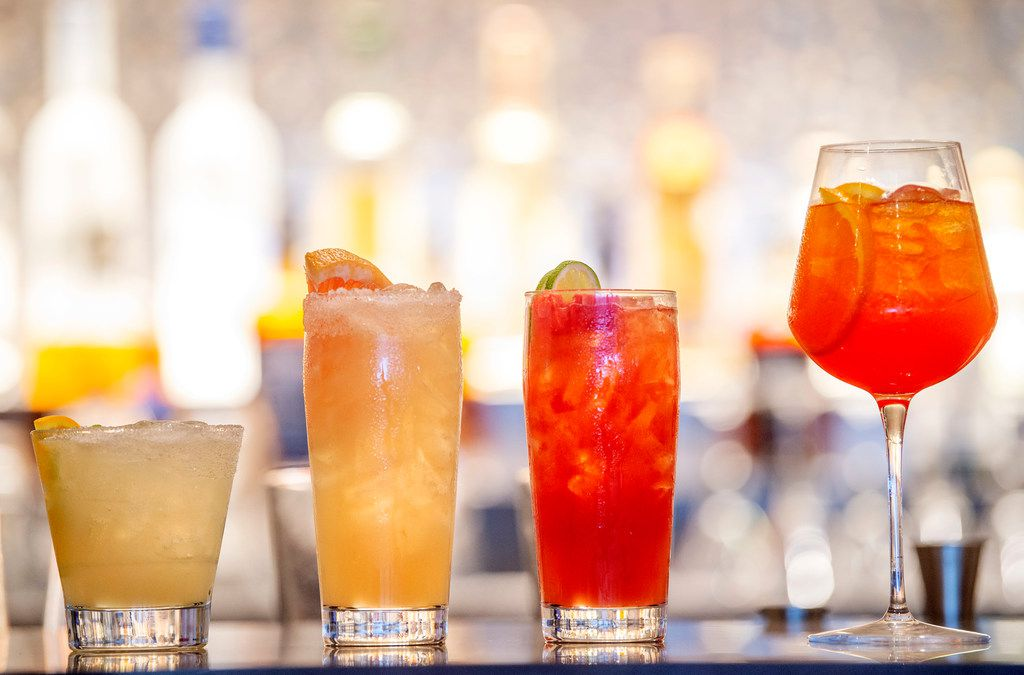 An assortment of cocktails is displayed in the bar of the Flagship First Dining area in the new American Airlines Flagship Lounge on Monday, May 13, 2019 in Terminal D at DFW Airport in Grapevine, Texas. (Jeffrey McWhorter/Special Contributor)