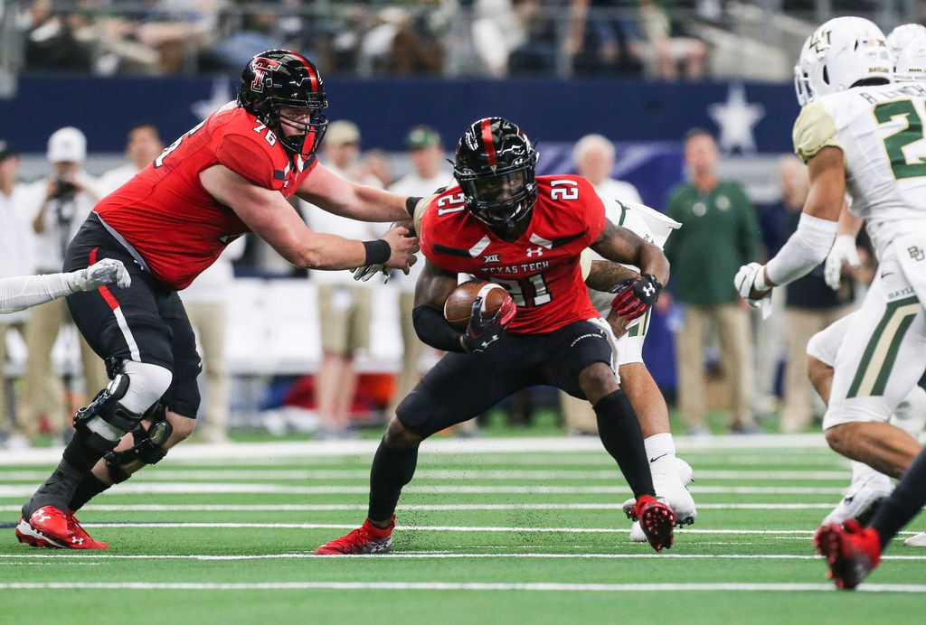 Texas Tech Red Raiders running back Da'Leon Ward (21) makes a run during the second half of a matchup between Baylor and Texas Tech on Saturday, Nov. 24, 2018 at AT&T Stadium in Arlington, Texas. (Ryan Michalesko/The Dallas Morning News)