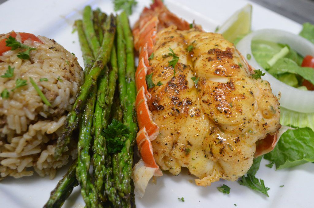 Ragin' Crab Cafe's Valentine's Day menu will include lobster tails served with dirty rice and garlic butter broccoli.