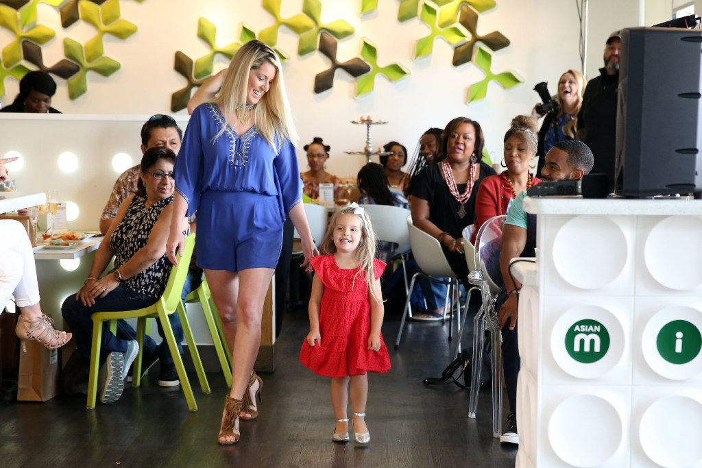 Sarah Vobora models with daughter Elealeah Vobora at a fashion show event benefiting Genesis Women'•s Shelter at Asian Mint in Dallas on June 4.