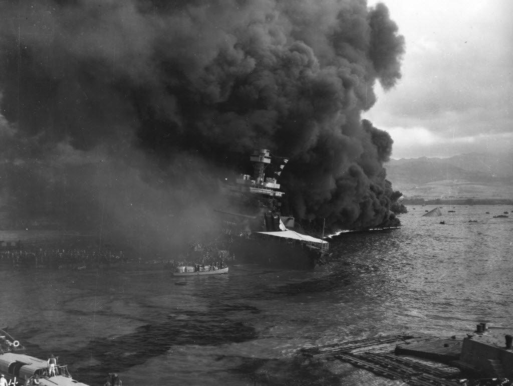 Raging fires force the crew of the battleship USS California to abandon ship during the Japanese attack on Pearl Harbor in Hawaii on Dec. 7, 1941.