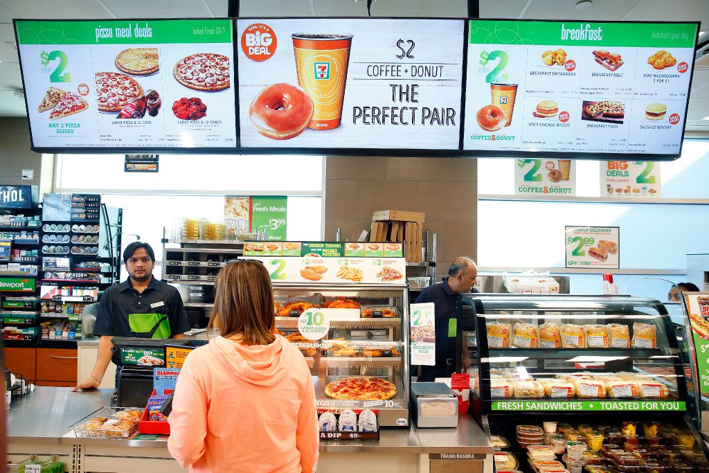 7-Eleven uses a new digital menu sign above the cash  register in a convenience store located at it's new headquarters building in Irving, Texas, Monday, January 23, 2017. (Tom Fox/The Dallas Morning News)