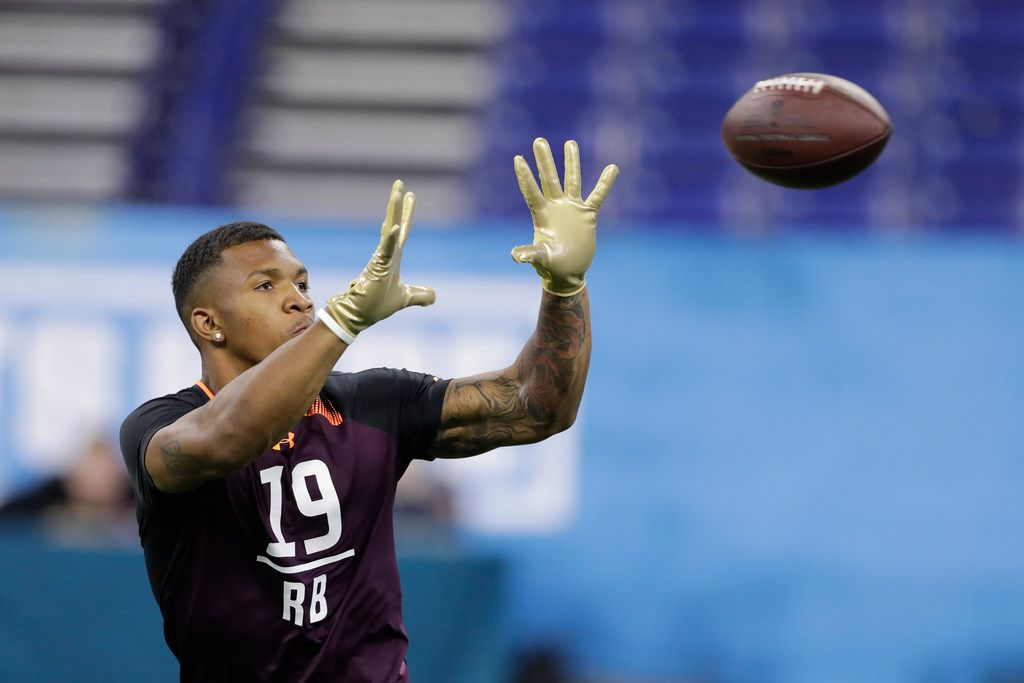 Memphis running back Tony Pollard runs a drill during the NFL football scouting combine, Friday, March 1, 2019, in Indianapolis. (AP Photo/Darron Cummings) ORG XMIT: INDC1