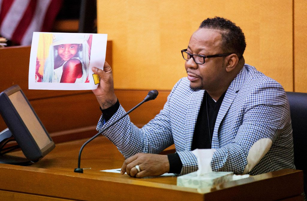 Bobby Brown holds up a picture of his daughter, Bobbi Kristina Brown, during a wrongful death case against her partner, Nick Gordon, in Atlanta, Thursday, Nov. 17, 2016. (AP Photo/David Goldman, Pool)