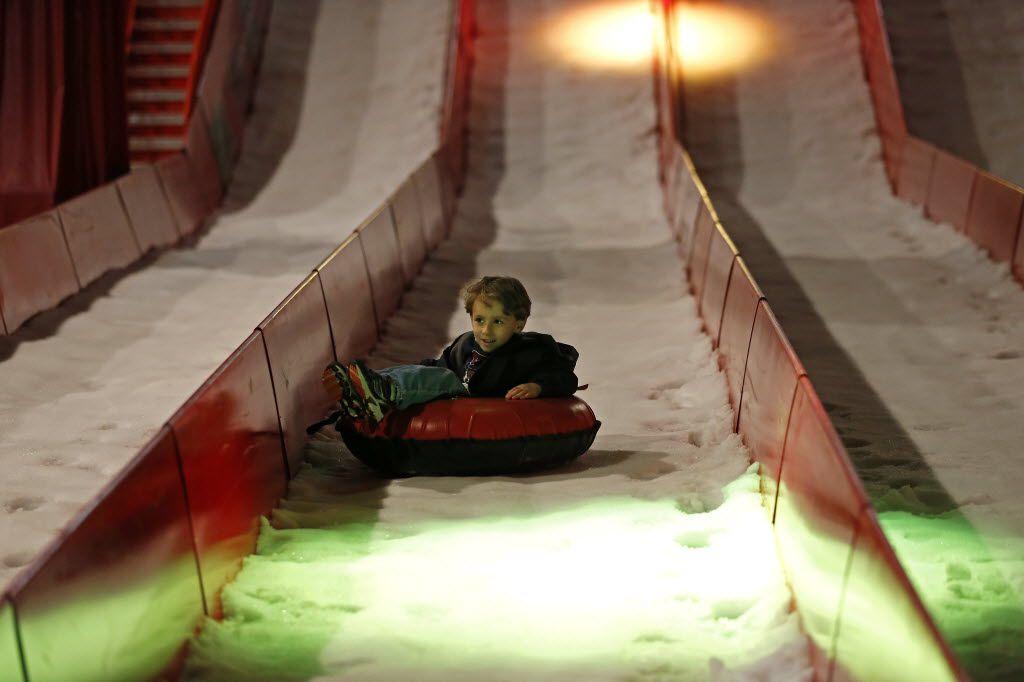 Hayden Atkinson, 4, of Houston, glides down on the ice slide.