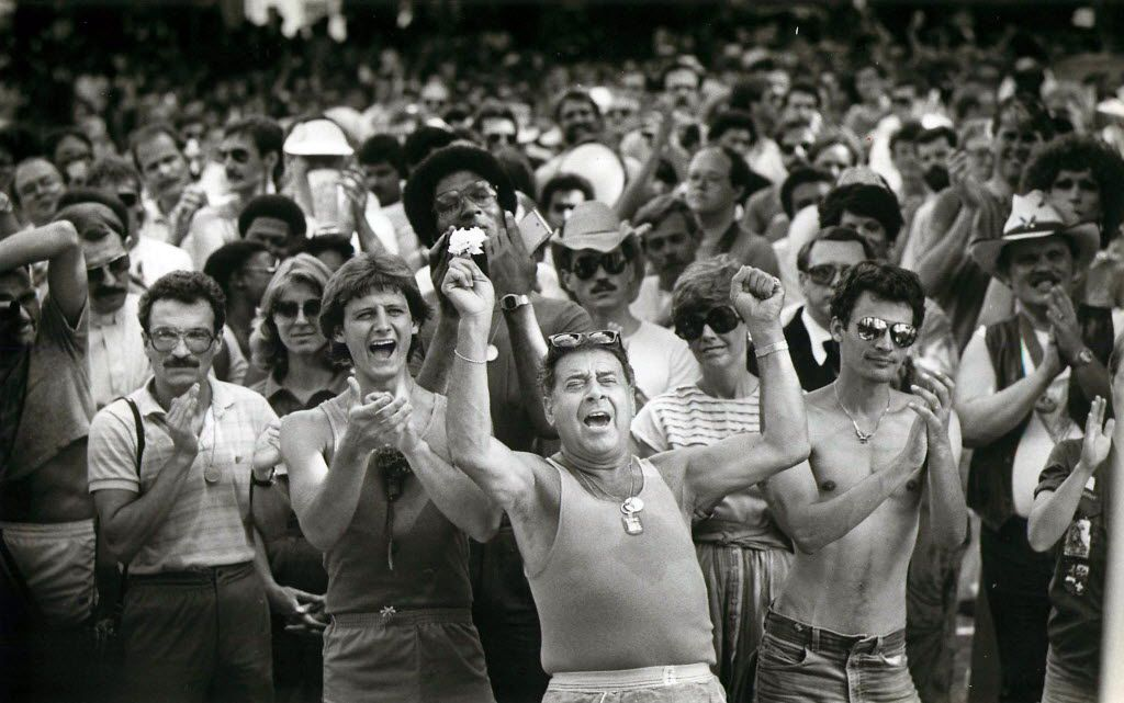 Supporters applaud a speaker in Lee Park after the pride parade on June 19, 1983.