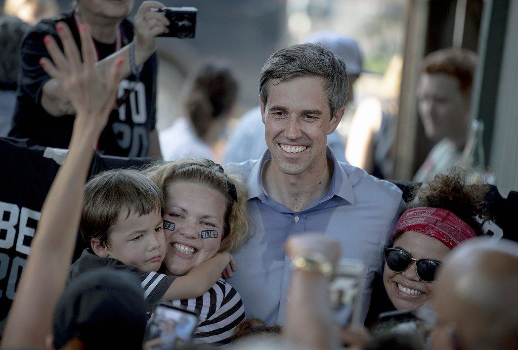 Democratic presidential candidate Beto O'Rourke poses for a photo with supporters following a campaign rally on Friday in Austin.