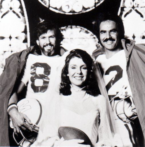 A promotional photo for the 1977 movie adaptation of Dan Jenkins' novel Semi-Tough includes stars Kris Kristofferson (left), Jill Clayburgh and Burt Reynolds.