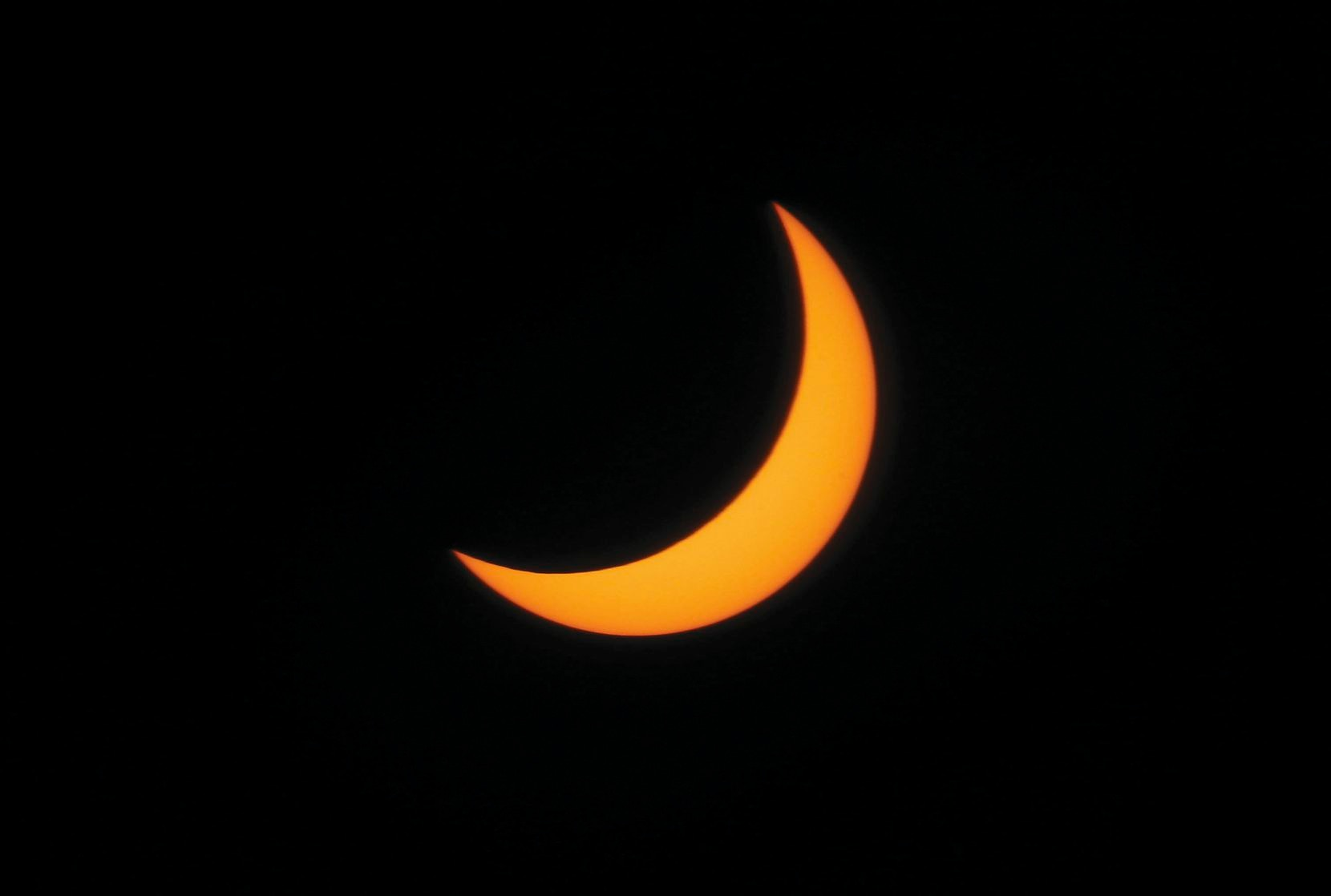 The moon passes in front of the sun at 1:09:51 p.m. Aug. 21, the fullest the solar eclipse could be seen from downtown Dallas.