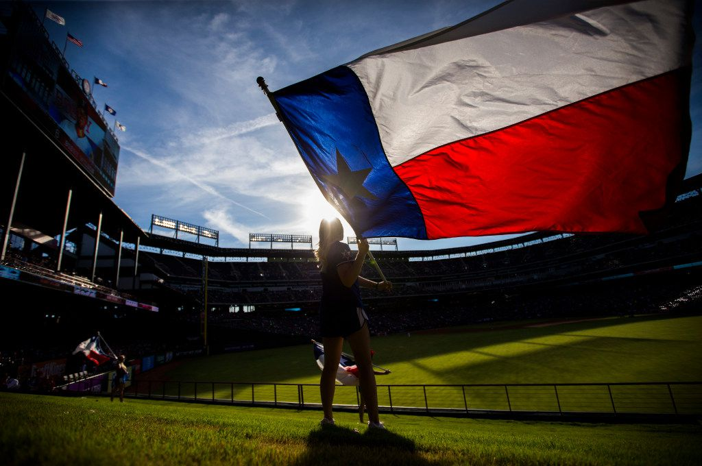 Texas Rangers Six Shooter Jaime Thatcher waves a Texas flag in the outfield before their game against the Houston Astros on Wednesday, June 8, 2016 at Globe Life Park in Arlington, Texas. (Ashley Landis/The Dallas Morning News) ORG XMIT: DMN1606081913174880