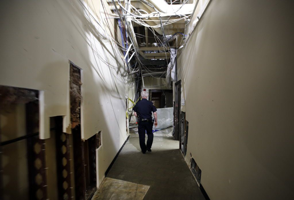 Dallas County College police chief Joseph Hannigan views the spot where the gunman was cornered by police in a second story hallway at El Centro College in downtown Dallas, July 19, 2016. The police detonated a bomb, killing the gunman and causing all the structural damage. (Tom Fox/The Dallas Morning News)