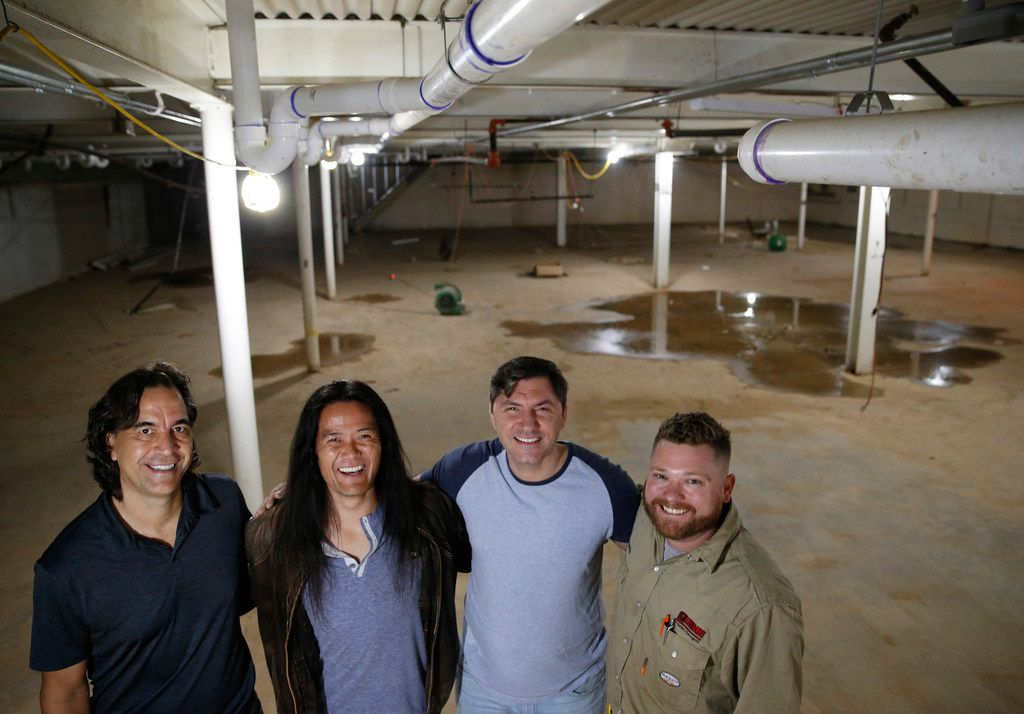 From left: HD Design Group principal Mark R. Hopper, Revolving Kitchen founder Tyler Shin, chef/partner Peja Krstic, and general contractor Kenneth Nitchepose for a photo on the lower level of Revolving Kitchen, which will be used for food storage, offices and cooler space.