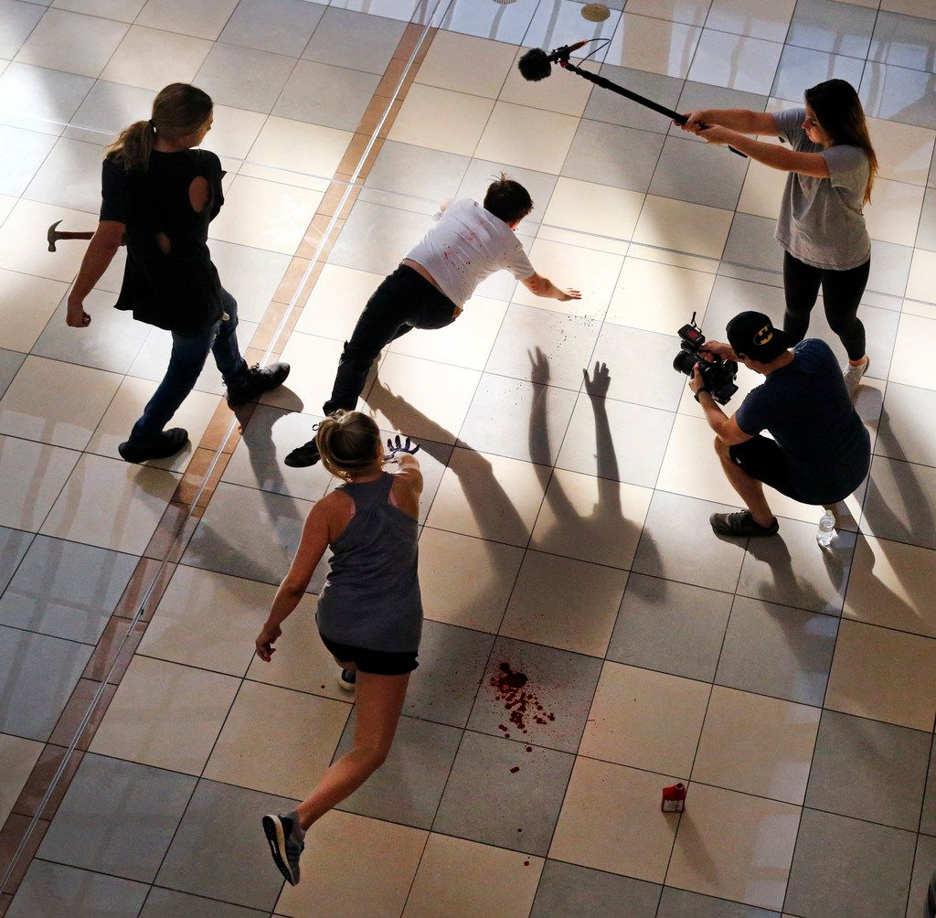 """Kids from DTV Studios, including actors Caden Smith, Jacob Pasteur, Kailyn Machado and director Curt Mega (far right,) film a scene inside the empty Collin Creek Mall in Plano, Wednesday, July 24, 2019. The student film summer camp is using the abandoned mall to shoot """"The Experiment,"""" a short film made in conjunction with Gray Studios in Los Angeles."""