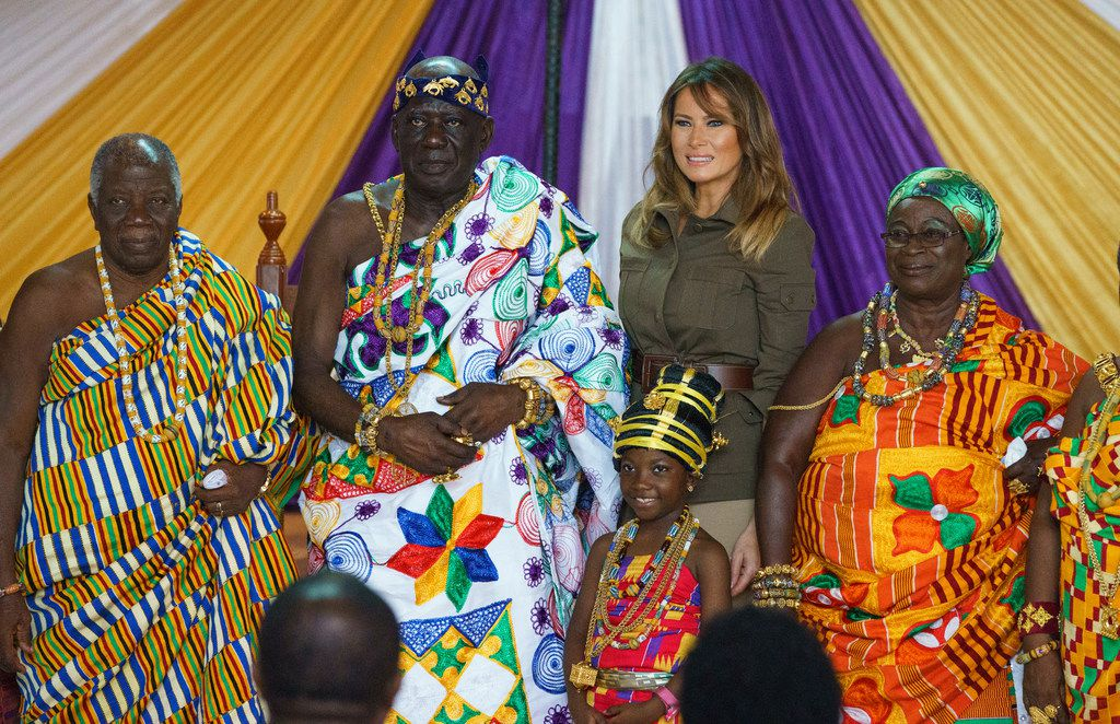 First lady Melania Trum ( second from right) and Osabarimba Kwesi Atta II, the chieftain of the Cape Coast Fante (second from left), and others pose for photographs during a cultural ceremony at Emintsimadze Palace in Cape Coast, Ghana, on Wednesday, Oct. 3, 2018. The first lady is visiting Africa on her first big solo international trip.