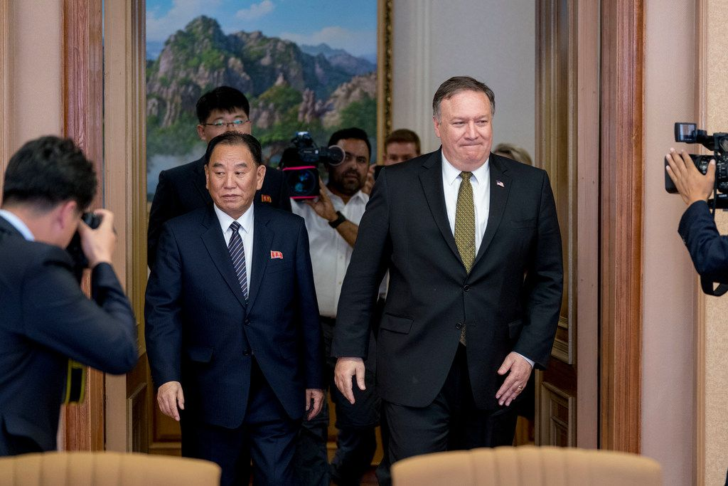 U.S. Secretary of State Mike Pompeo, right, and Kim Yong Chol, left, a North Korean senior ruling party official and former intelligence chief, return to discussions after a break at Park Hwa Guest House in Pyongyang, North Korea, Saturday, July 7, 2018.
