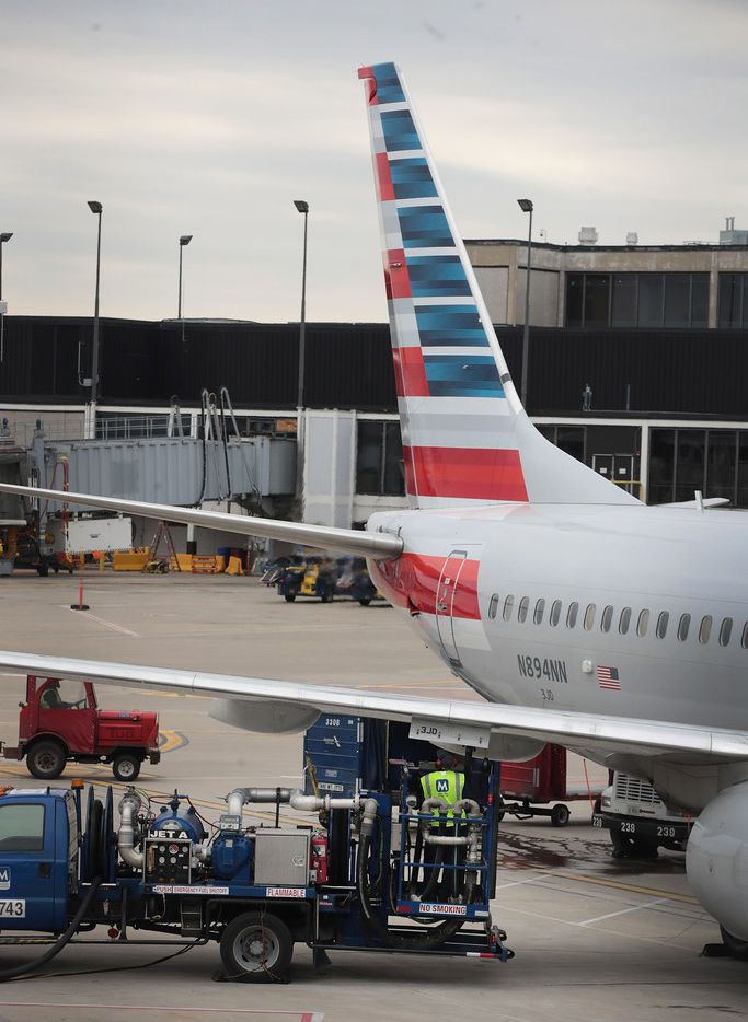 CHICAGO, IL - MAY 11:  A worker loads fuel onto an American Airlines aricraft at O'Hare International Airport on May 11, 2018 in Chicago, Illinois. Today American Airlines held a ceremony to mark the opening of five new gate at the airport.  (Photo by Scott Olson/Getty Images)