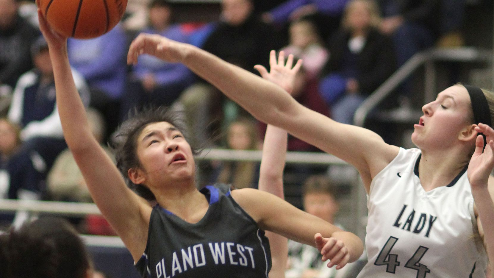 Flower Mound junior Lauren Cox (44) blocks a shot attempt by Plano West junior Natalie Chou (24) in the first half of their basketball game at Flower Mound High School on Friday, January 9, 2015. (Photo taken by Kelley Chinn/Special Contributor)