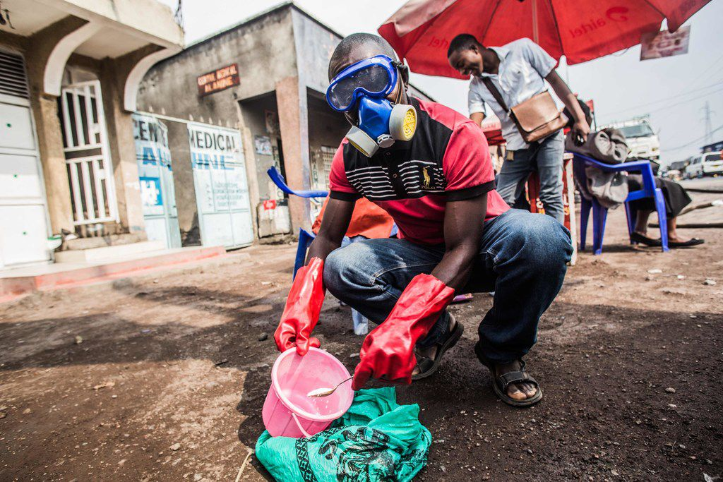 A health worker wearing protective gear mixed water and chlorine in Goma, Congo, in July.