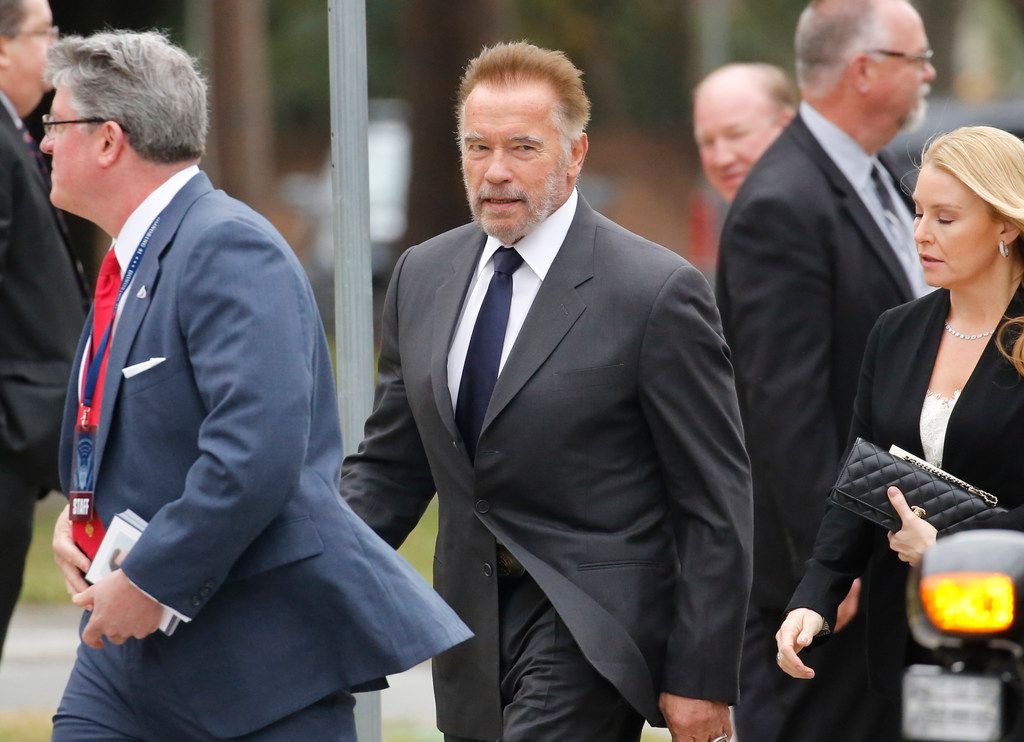 Arnold Schwarzenegger arrives at the funeral service for George H.W. Bush.