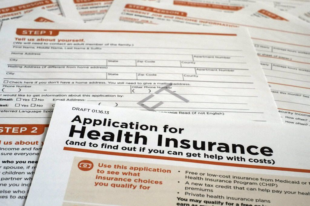 A draft copy of the  Health and Human Services Department form to apply for low-cost insurance from Medicaid or the Children's Health Insurance Program is photographed in Washington, Tuesday March 12, 2013.  (AP Photo/J. David Ake)