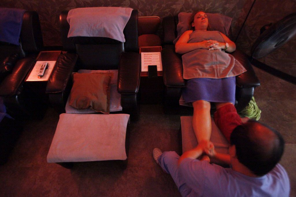 Catherine Fisher receives a foot massage inside King Spa, on Wednesday, Oct. 06, 2015 in Dallas. Ben Torres/Special Contributor