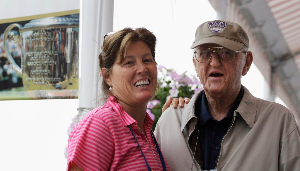 Dan Jenkins poses for a photo with his daughter, longtime Washington Post sportswriter and columnist Sally Jenkins, in August 2009 at the PGA Championship at Hazeltine National Golf Club in Chaska, Minn. Jenkins died Thursday at 90.