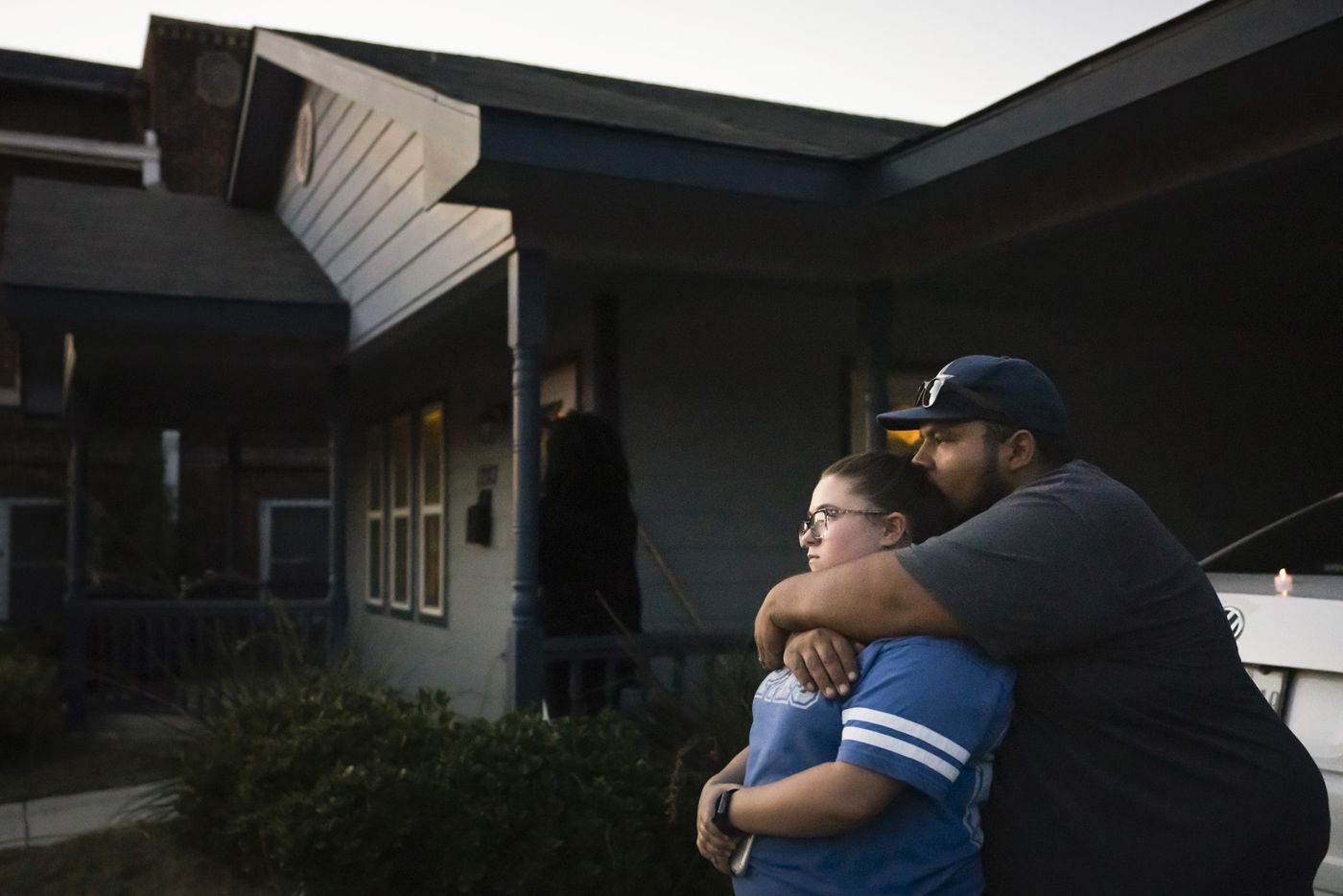 Destinie and Floriberto Bartolo mourn for their friend Atatiana Jefferson who they say they have known since high school, outside the house where Jefferson was shot and killed by a police officer, during a community vigil for Jefferson on Sunday, Oct. 13, 2019, in Fort Worth.