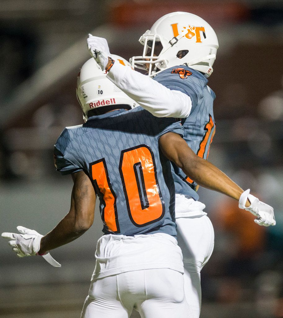 Lancaster wide receiver Majik Rector (10) celebrates with wide receiver Latrell Caples (15) after a touchdown during the first quarter of a high school football game between Lancaster and Mansfield Lake Ridge on Friday, September 22, 2017 at Vernon Newsom Stadium in Mansfield, Texas. (Ashley Landis/The Dallas Morning News)