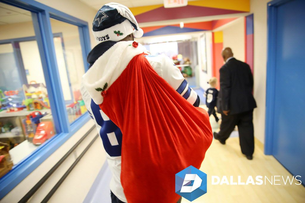 Dallas Cowboys wide receiver Dez Bryant carries a sack of gifts for patients during a visit to Medical CityChildren's Hospital in Dallas Monday December 5, 2016. Players, who were joined by the Dallas Cowboys Cheerleaders, brought gifts for patients and signed their autographs.